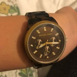 MK tortoise shell watch
